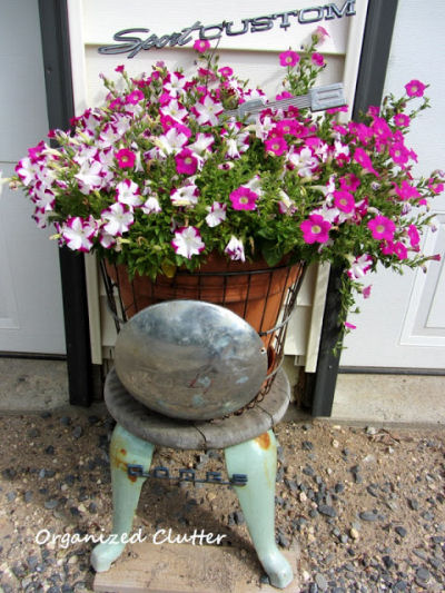 Car parts recycled into a cute garden planter