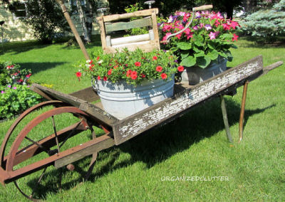 Wheel barrow planter with galvanized tubs and washtub ringer.