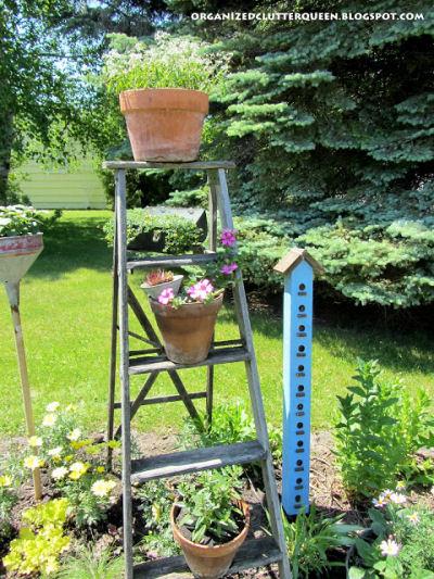 Step ladder planter in a garden bed
