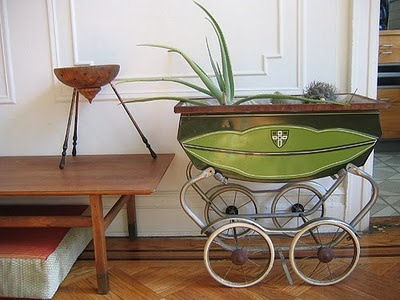 Old baby pram used as a planter