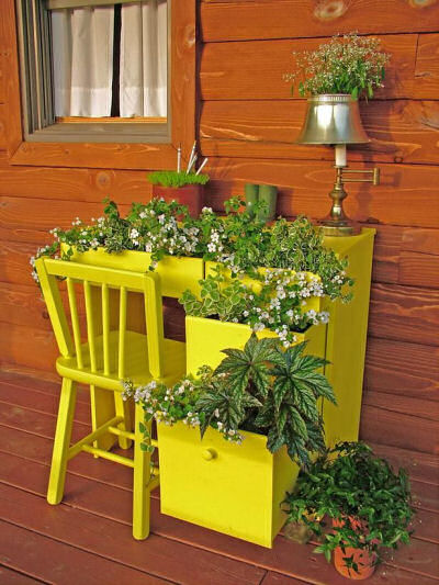 office desk and chair used as planters