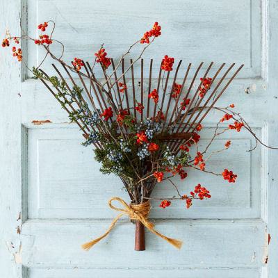 Old rake head and decorations = a fall door decoration.