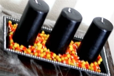 Candy corn and black candles. Easy fall decor. Swap the colors for any season!