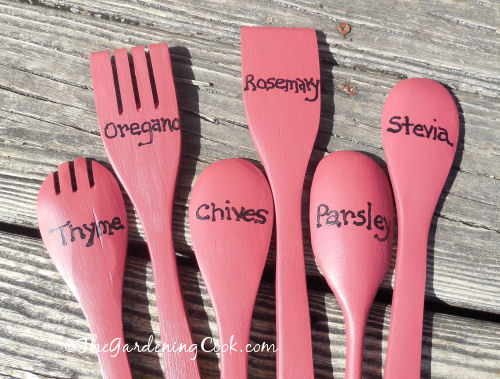 Herb names painted on wooden spoons