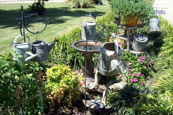 Hanging garden of watering cans