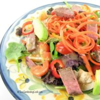 Beef veggie salad with pear gorgonzola dressing.