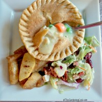 Chicken pot pie with cinnamon apples and cranberry and walnut salad