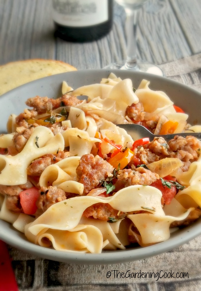 This milk Italian sausages with drunken noodles recipe has a big ole splash of wine and loads of fresh herbs and veggies. It's on the table in 15 minutes, if you can believe it and tastes scrumptious! thegardeningcook.com