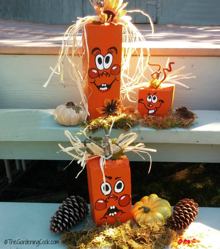 Scrap wood pumpkins with moss and pine cones