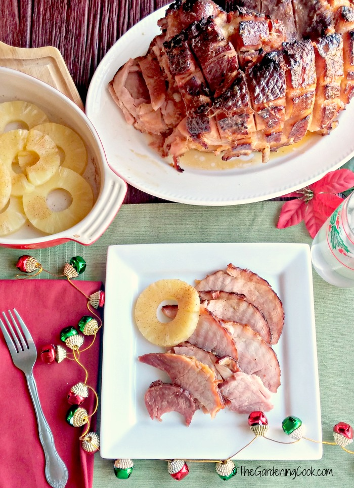 Cooking the perfect holiday ham is as easy as your secret ingredients for the glaze. This recipe is simple to do and tastes heavenly. thegardeningcook.com #ForTheLoveOfHam