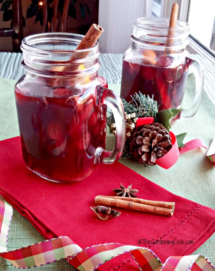 This slow cooker spiced wine has the most amazing flavor. It is perfect for those nights when the cold is nipping at your nose. thegardeningcook.com #HolidayHoneyGranules #ad