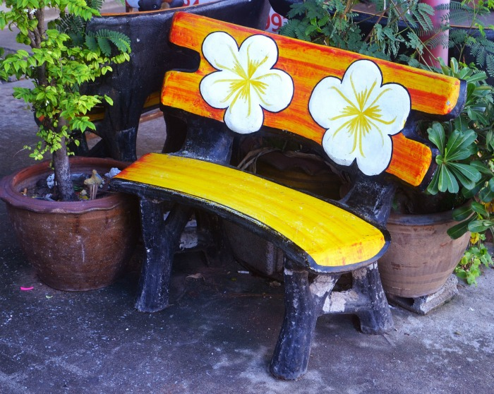 Garden bench with a flowered back