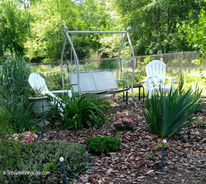 Garden swing and adirondack chairs
