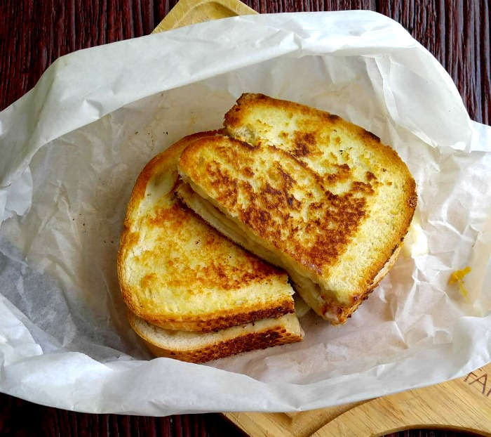 Oven baked grilled cheese sandwiches are super crispy if you use parchment paper.