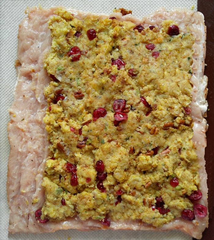 Spread the cranberry pecan stuffing on the flatted pork loin