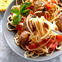 Dig into these Abruzzese Meatballs in a home made buttery tomato sauce