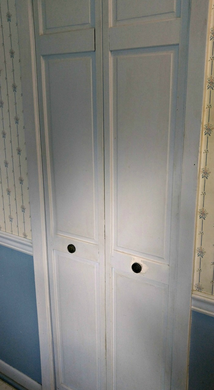 This concertina pantry door will be replaced with a sliding barn board door
