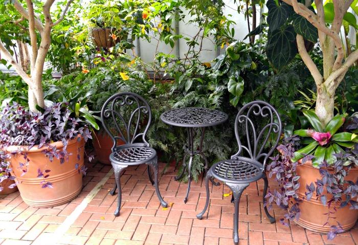 Black patio bistro setting in the conservatory at Biltmore Estates