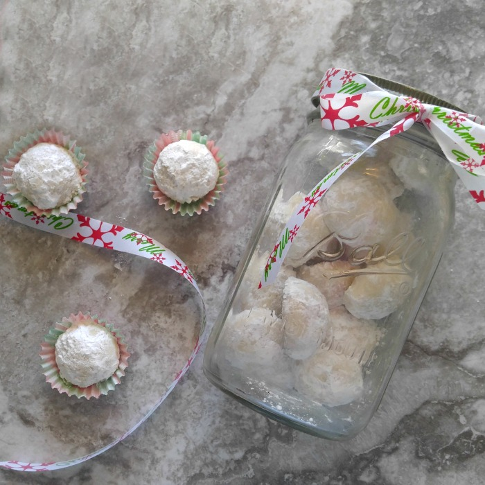 Mason jars make a cute cookie jar for these lemon snowball cookies