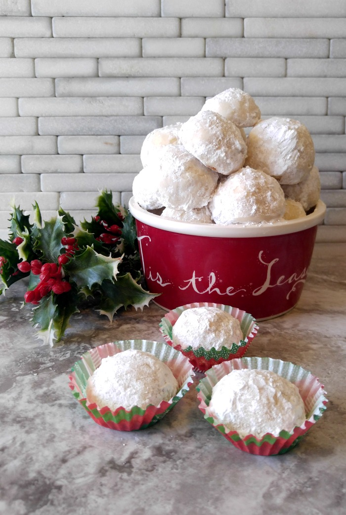 Lemon Snowball Cookies in a pretty holiday serving dish