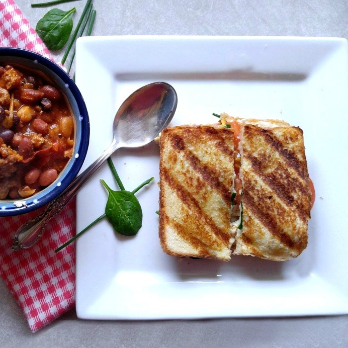 Chicken cheese panini with a bowl of slimmed down turkey chili