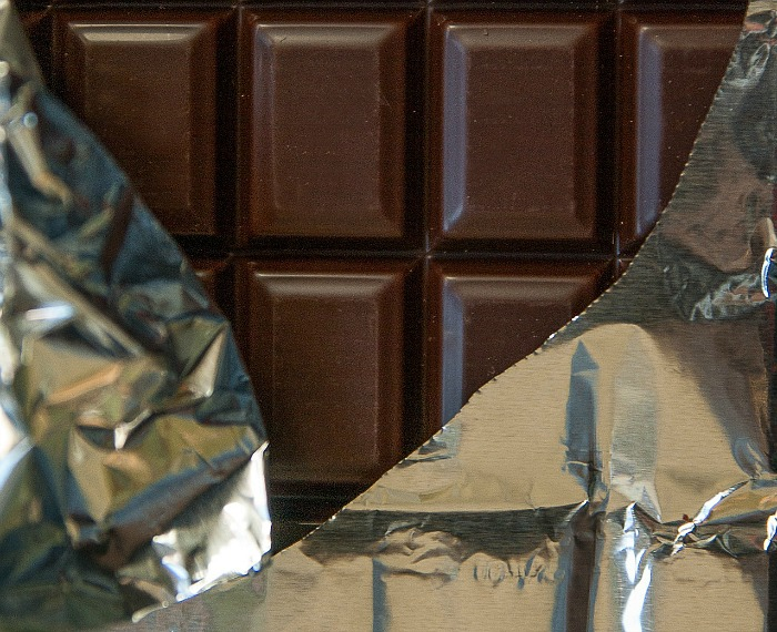 Eat dark chocolate instead of milk chocolate as a snack