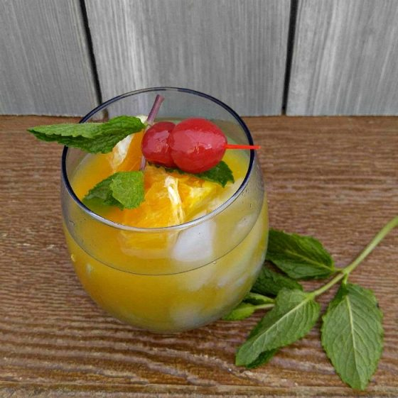 Garnish your Orange Cherry Mocktail with some maraschino cherries and fresh mint leaves