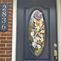 The Easter Grapevine Door Swag is a pretty way to welcome guests