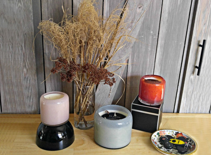 Have a trio of candles waiting for your guests on the entry table.