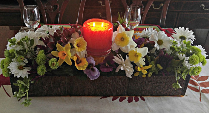 Candle centerpiece with fresh flowers