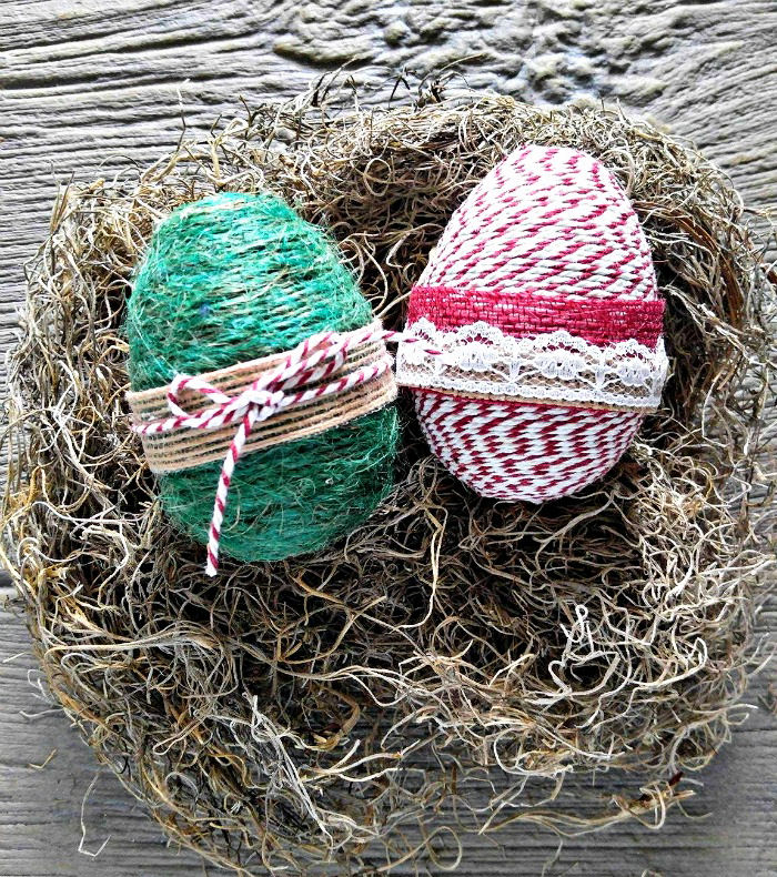 Green and striped rope wrapped eggs with burlap ribbon