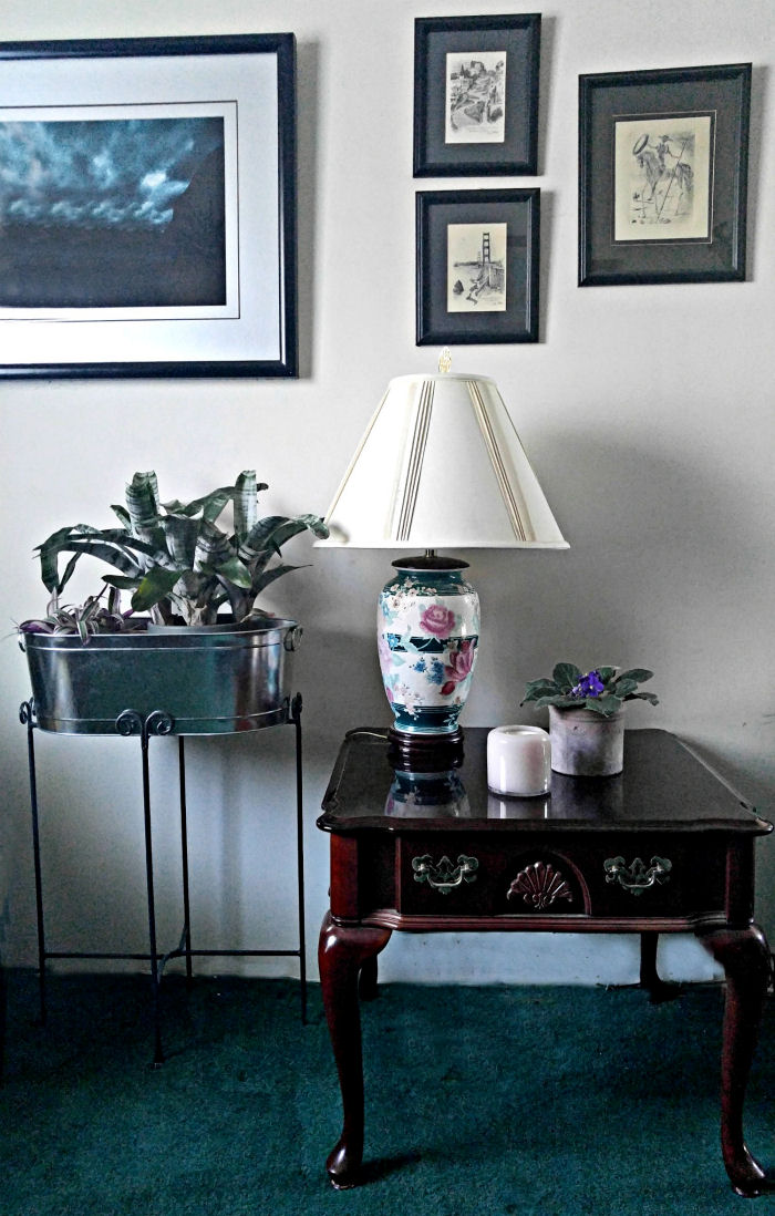 A single candle on a bare table can coordinate with the lamp and planter for instant decor.