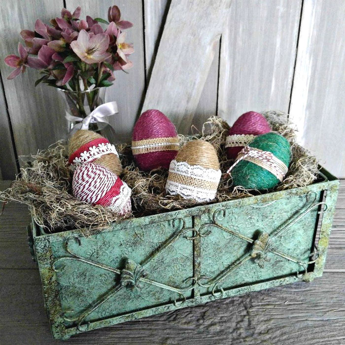 Bin of rope wrapped eggs with burlap ribbon