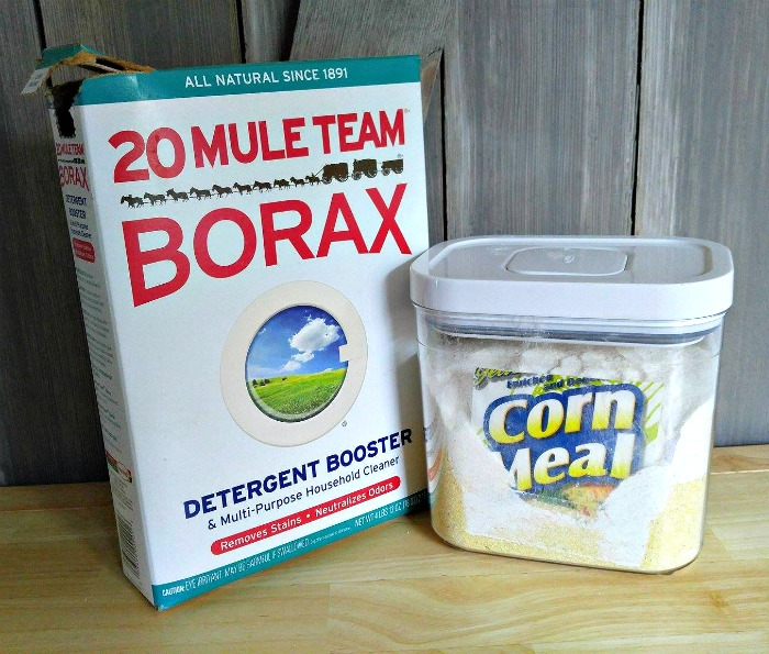 Borax and corn meal can be used to dry flowers