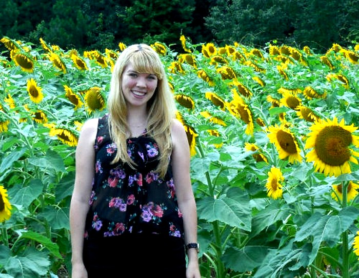 My daughter in a field of sunflowers