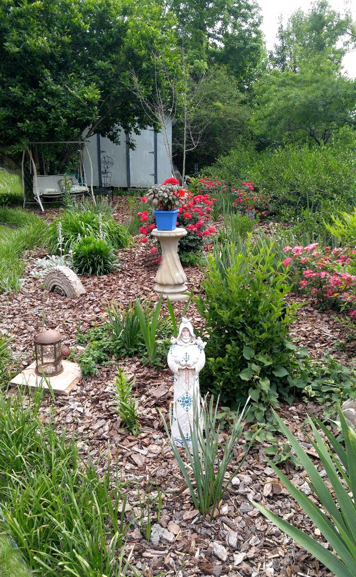 Summer garden bed and statue