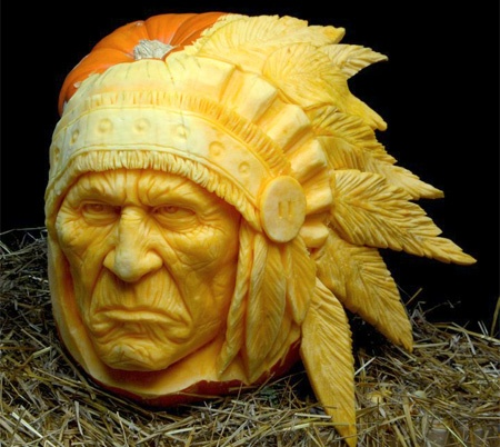 Pumpkin carved into a Native American chief with a headdress
