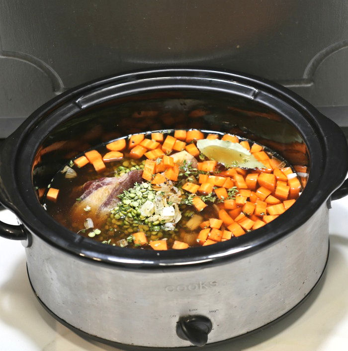 Split pea soup in the crock pot ready to cook
