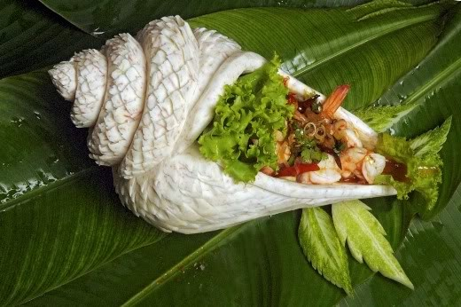 vegetable carving of a seashell filled with food