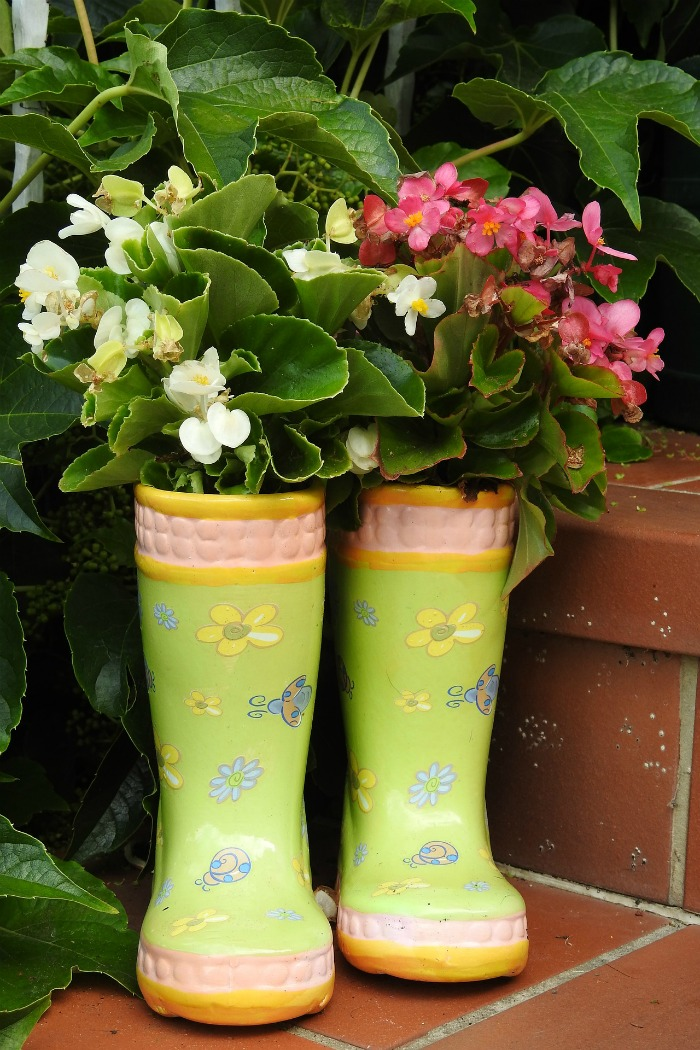 child's boots repurposed into planters