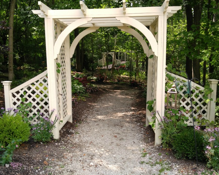 Traditional white arbor from Beech Creek Botanical Gardens.