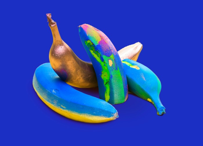Colorful banana still life made with bright paint colors.