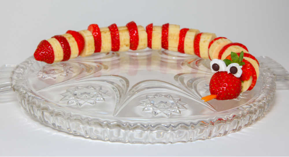Strawberries and bananas combined with mini marshmallows and chocolate chips to make a snake.