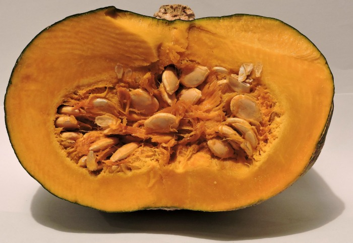Scoop out your pumpkin seeds and roast them.