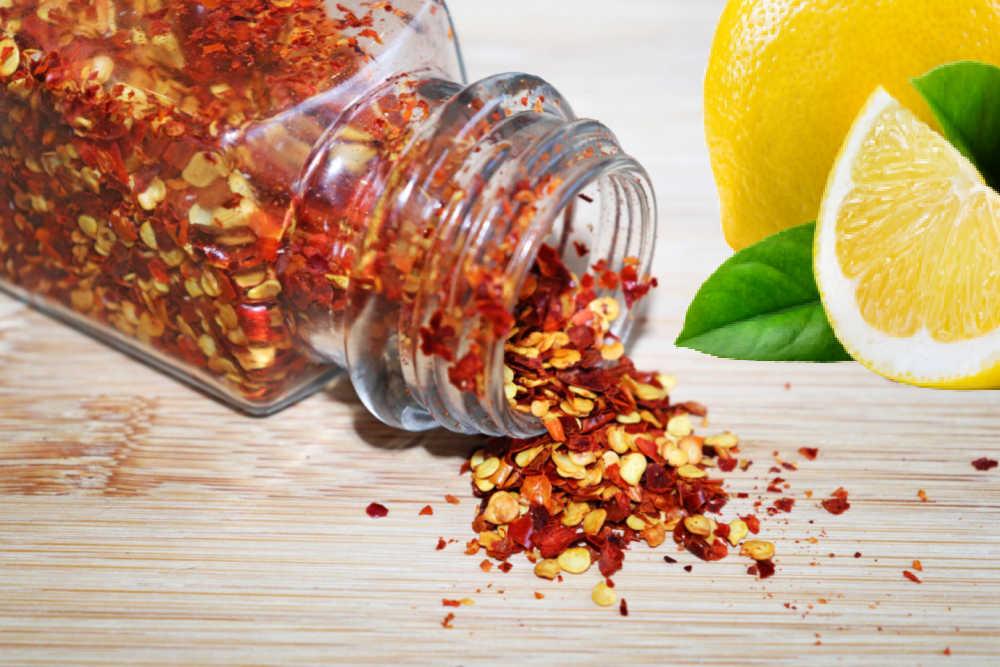 Jar of red pepper flakes and fresh lemons.