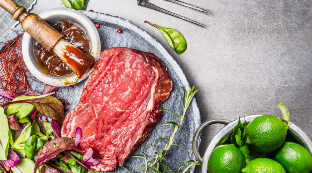 Mojo marinade with steak and limes.