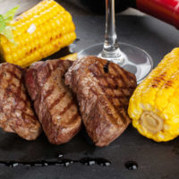 Montreal steak recipe with grilled corn.