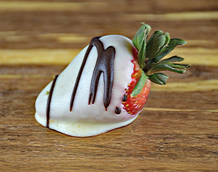 white chocolate strawberries with a dark chocolate drizzle