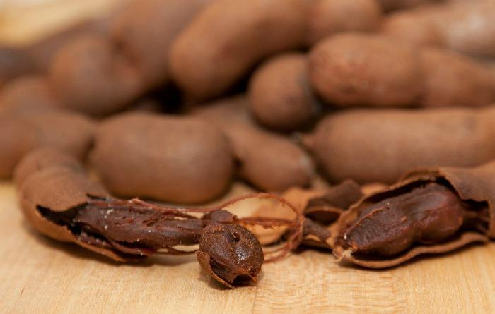 tamarind is a sour fruit that grows in a pod