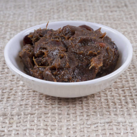 Tamarind paste in a white bowl